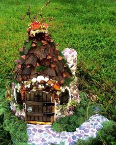 Fairy house made of stones, tree bark, pine cones, sea shells, acorns, moss, vine twigs and dried flowers. Each stone was selected and placed by Ella Sophia. 2015 Grand Champion Award,