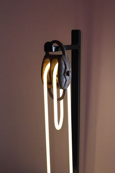 small pulley, with warm white neon. artist: jeroen gordijn