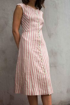 The vintage inspired Rhea Dress is sophisticated and sexy at the same time. Gently rounded cap sleeves, signature spaced button down Kurta Designs Women, Kurti Neck Designs, Kurti Designs Party Wear, Blouse Designs, Cotton Dresses Online, Linen Dresses, Frock Dress, Dress Red, Dress Shorts Outfit