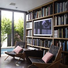By building a bookshelf that accommodates a flatscreen, you show guests that you value literary arts as well as some good old-fashioned television entertainment. The visual effect of the books surrounding the flatscreen is extremely pleasing as well. Source