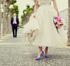 A pretty tea-length Paris Connection wedding dress with blue bridal shoes, photo by Paco and Betty.