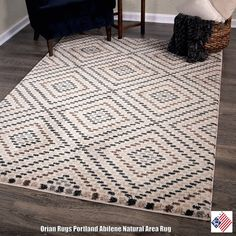 howcase modern style with Orian Rugs Abilene Area Rug, featuring a modern layered diamond motif cast in neutral hues over a cream-colored background...