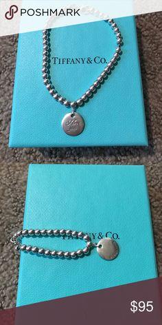 "Tiffany& Co ""I love you"" Bracelet Tiffany& Co ""I love you"" Bracelet great conditon! I can get it cleaned before I ship it :) Tiffany & Co. Jewelry Bracelets"