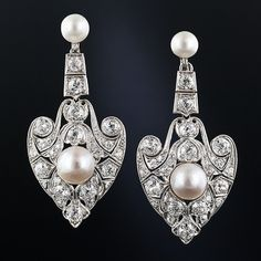 Pearl and diamond drop earrings, circa 1900.