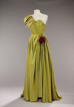 Evening dress Design House: House of Patou (French, founded 1919) Date: 1947–49 Culture: French Medium: synthetic Dimensions: Length at CB: 65 in. (165.1 cm) Credit Line: Brooklyn Museum Costume Collection at The Metropolitan Museum of Art, Gift of the Brooklyn Museum, 2009; Gift of A.M. Tenney Associates, Inc., 1950