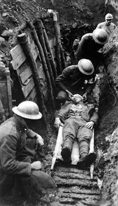 WWI, 22 March 1918; Marine receiving first aid before sent to hospital in rear of trenches. Toulon Sector, France. - Sgt. Leon H. Caverly, USMC. National Archives ( http://spiritualpilgrim.net/03_The-World-since-1900/02_World-War-One/02f_1918-2.htm)