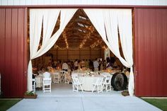 machine shed reception ceiling decor | barn entrance photo by Andrea Murphy Photography via Style Me Pretty ...