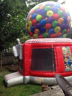 Giant gumball machine bouncy house:)