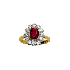 burmese (no heat) ruby with diamonds, set in yellow and white gold. Accompanies a gemmological report from AGL. Ring size 6 US