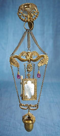 This comes from Theriault's Auctions.  It's a French Ormolu and Mother-Of-Pearl Chatelaine.  And it's gorgeous!!
