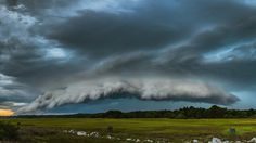 "Photographer Josh Blash calls this image Skyfall. He wrote: ""Everything is quiet, a little super dangerous."" Shelf clouds are what meteorologists call arcus clouds. They're low, mostly horizontal clouds, usually associated with a thunderstorm's leading edge."