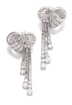 PAIR OF DIAMOND EAR CLIPS, BULGARI, 1960S Each designed as a ribbon, set with circular-cut and baguette diamonds, signed Bulgari.