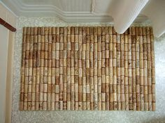 This bath mat requires just three materials: shelf liner, hot glue, and 175 wine corks.  www.craftynest.com