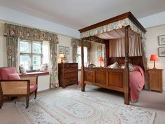 The magnificent master bedroom at Hewthwaite Hall with four poster bed, cosy window seats and thoughtful touches.