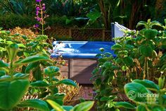 Create a tropical retreat in your backyard - all you need is a Hot Tub and a few plants and transport yourself to Hawaii!