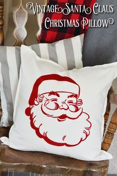 Everyone needs this Vintage Santa Claus Christmas Pillow in their home. It's pretty simple to make with your Cricut and EasyPress + it's so fun! Get the details on the blog.