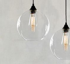 in stock - Clear glass or tinted grey.  Gorgeous 30cm Hand Blown Orb available in either a clear or tinted grey glass shade with an open bottom - nice and easy to replace bulbs! (there may be some small bubbles present in the glass)  We have other beautiful clear shaped pendants to help you be creative in your design - See the photos attached as an example.  Dimensions of shade  Colour Clear Glass Diameter 30 cm  Height 30 cm  Black c...