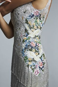 Silver beaded tasseled dress with color birds embroidery on the waistline