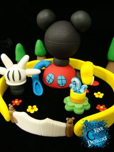 This is awesome! Too pricey to not include the cake, but still awesome! Mickey Mouse Clubhouse Cake Topper Set by KrazyKoolCakeDesigns, $195.00