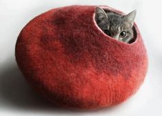 These beautiful pet beds that look like caves or cocoons provide cozy places for cats, add a nice rich color to your interior decorating and make your room cat-friendlier and warmer. The pet beds are