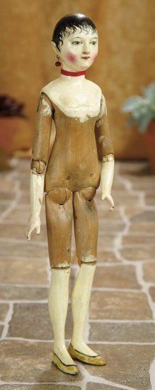 old wood body doll..with exquisite painting and carving