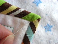 Binding Tips: tutorial.   Idea for a simple craft: personalize a store-bought blanket using cute fabric.