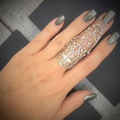 - Our Elven Design Knuckle Ring features silver intricate, floral woven pattern. This ring is a little less than 2.5 inches long. The graceful, ethereal Elven design will be the perfect adornment for