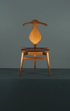 Modern valet chair by furniture designer hans wegner. One day I hope to have one of these! I love the functionality of the design combined with beautiful lines.