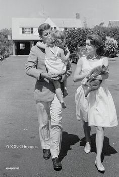 John and Jacqueline Kennedy on Outing with Their Daughter