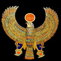 A jewelled falcon of Tutankhamun holding the 'ankh' or sign for life in Ancient Egypt (Cairo Museum)