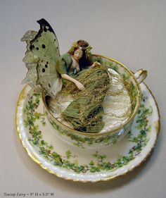Fairy in a teacup - love the glitzy materials she uses, and the natural wings - from the MINIATURES I gallery of artist Stephanie Blythe