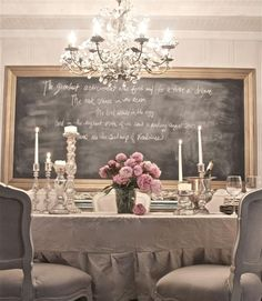 MBeagle's Tip: Giant chalkboard + traditional, neutral-colored furniture create French cafe atmosphere.