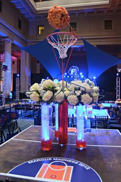 Custom #stage #sculpture, basketball net container, florals, lighting, table vinyls, WE DO IT ALL! #wedoevents