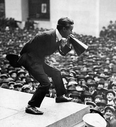 1917-New York, NY: Charlie Chaplin addressing crowds via megaphone on the steps of Sub-treasury Building  (Wall Street) in New York during World War I third Liberty Loan Rally.