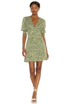 With a soft green and easy silhouette, you will wear this dress again and again. Just as cute with sneakers as with a pair of high-heel sandals, you'll quickly get your wear out of it. #weddingguestdress #weddingguestoutfit #rehearsaldinnerdress #dressestoweartoawedding #southernliving Halter Neck Maxi Dress, Ruffle Dress, Spring Dresses, Dresses For Work, Rehearsal Dinner Dresses, Dress With Sneakers, Mini Dress With Sleeves, Buy Dress, Free People Dress
