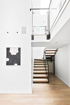 Black and white foyer with high ceilings and modern art