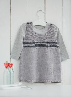 Simple to make pinafore dress, a quick and easy pattern for children. Find this pattern and more inspiration at LoveKnitting.Com.