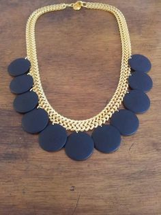 Thick necklace chain gold plated 24-carat matte combined with vintage plastic coins matte black color.