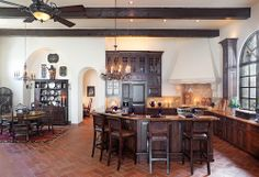 I like the space in this kitchen but would move the stove and put in a brick oven as well.