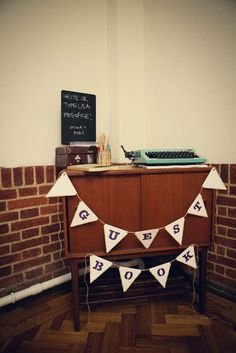 typewriter – guestbook | A DIY Village Hall Wedding & A Bride Who Designed her own Dress: Laura & Mike