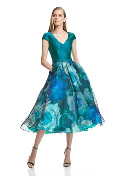 "Brilliantly hued, this t-length dress features a cap sleeve bodice and printed silk skirt giving it an ultra feminine charm. 50 ½"" from shoulder to hem V-neck C"