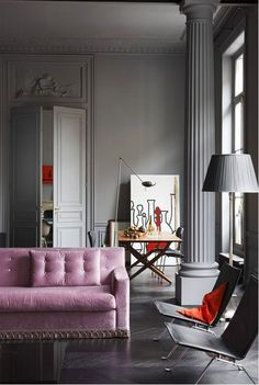 purple sofa in this french girl chic modern living room