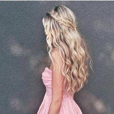 Long wavy brunette blonde with side braid hairstyle. Elgant look