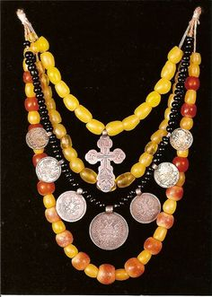 "Ukrainian folk beads: amber, corals, silver ""ducats"", silver cross. Central…"