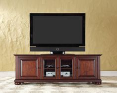 Alexandria 60 Inch Low Profile TV Stand in Vintage Mahogany is a part of Alexandria Collection by Crosley  #tvstand #4thofJulysale #HomeDecor #interiordesign #InteriorDesigner #HomeDecorating #furniture #efurnituremart #HomeDecorator #decor - eFurnitureMart, eFurniture Mart