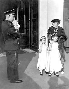 Magda Goebbels with her three oldest children; Helga, Hilde and Helmut along with an SS man