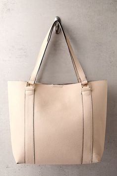 """A girl on the go needs a tote that can keep up, and the Style Script Beige Tote Bag has got your back! Soft vegan leather shapes this roomy tote with a matching, detachable coin purse. Carry by twin tote handles (with 10"""" drop)."""