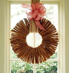 cinnamon sticks wreath is easy to make using a piece of hidden cardboard that you glue the sticks to (a foam circle works also). Use a piece of country fabric for a hanger and top off with a bow!!--So Simple!!!