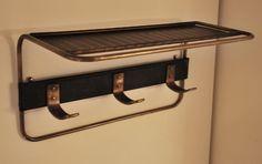 Porte manteaux en laiton et métal laqué noir de Mathieu Mategot France, c. 1950 H: 26 cm, L: 51 cm, P: 24 cm Prix sur demande