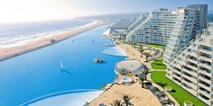 It's not every day that a photo causes an audible reaction, but these pictures of the  world's largest swimming pool are most definitely whine-worthy.  Yes, we told you about this glorious man-made pool that sits on the grounds of the San Alfonso d...